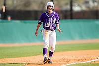 Cody Manzella (13) of the High Point Panthers takes his lead off of third base against the Coastal Carolina Chanticleers at Willard Stadium on March 15, 2014 in High Point, North Carolina.  The Chanticleers defeated the Panthers 1-0 in the first game of a double-header.  (Brian Westerholt/Four Seam Images)
