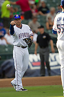 Round Rock Express third baseman Mike Olt (20) tosses the ball to pitcher Scott Richmond (55) during the Pacific Coast League baseball game against the New Orleans Zephyrs on June 30, 2013 at the Dell Diamond in Round Rock, Texas. Round Rock defeated New Orleans 5-1. (Andrew Woolley/Four Seam Images)