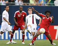 Michael Bradley kicks the ball away from Julian DeGuzman. USA beat Canada 2-1 in the semifinal of the 2007 Gold Cup at Soldier Field in Chicago on June 21 2007 and will meet Mexico in the final.