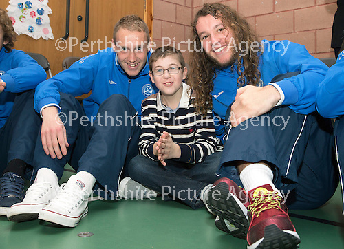 St Johnstone players visit Fairview School in Perth.....19.12.13<br /> Steven Anderson and Stevie May pictured with Christopher Pirie (12)<br /> Picture by Graeme Hart.<br /> Copyright Perthshire Picture Agency<br /> Tel: 01738 623350  Mobile: 07990 594431