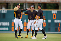 Bradenton Marauders outfielders Chris Sharpe (18), Travis Swaggerty (12), and Cal Mitchell (34) embrace after a Florida State League game against the Palm Beach Cardinals on May 10, 2019 at LECOM Park in Bradenton, Florida.  Bradenton defeated Palm Beach 5-1.  (Mike Janes/Four Seam Images)