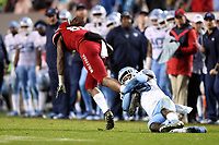 RALEIGH, NC - NOVEMBER 30: Storm Duck #29 of the University of North Carolina tackles Devin Carter #88 of North Carolina State University during a game between North Carolina and North Carolina State at Carter-Finley Stadium on November 30, 2019 in Raleigh, North Carolina.
