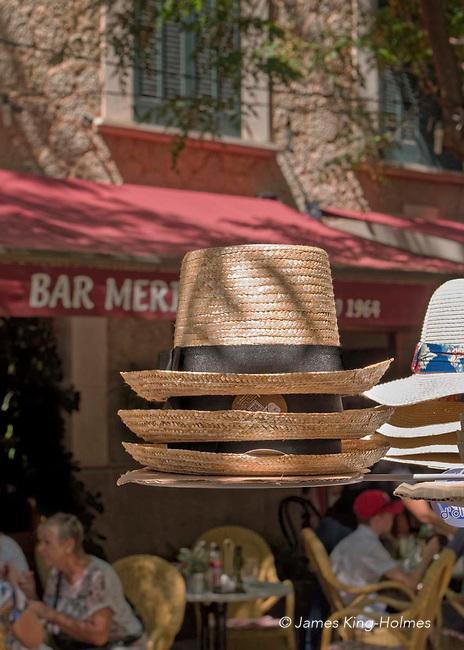 Hats for sale to tourists seeking shade. Via Blanquerna, Valldemossa, Mallorca, Spain