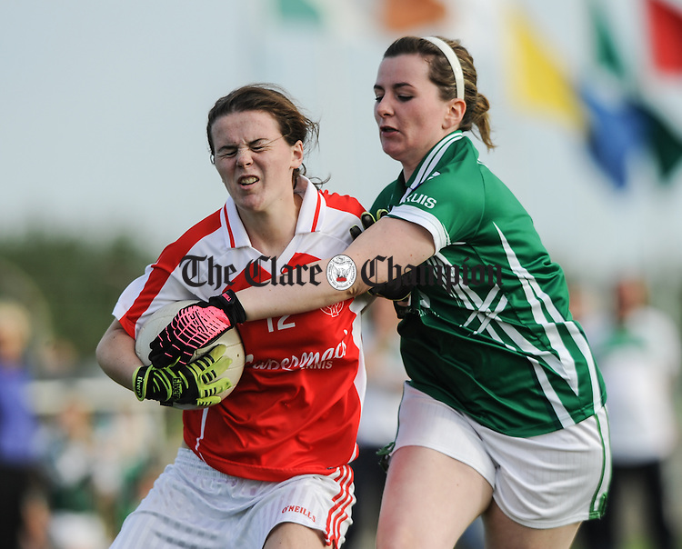 Sarah Cullinan of Eire Og in action against Mary Williams of Kilrush during their Junior Football county final at Doonbeg. Photograph by John Kelly.