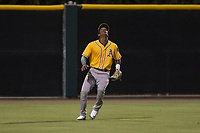 AZL Athletics left fielder George Bell (21) settles under a fly ball during an Arizona League game against the AZL Giants Black at the San Francisco Giants Training Complex on June 19, 2018 in Scottsdale, Arizona. AZL Athletics defeated AZL Giants Black 8-3. (Zachary Lucy/Four Seam Images)