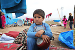 ARBAT, IRAQ: Kadthm Rufae Habeb, 4, from Derzor, Syria, is pictured in a refugee camp in Arbat, Iraq. ..The semi-autonomous region of Iraqi Kurdistan has accepted refugees from the conflict in Syria into several camps. Arbat lies near Sulaimaniyah in northeastern Iraq, approximately 500 kilometres from the Syrian border...Photo by Besaran Tofiq/Metrography