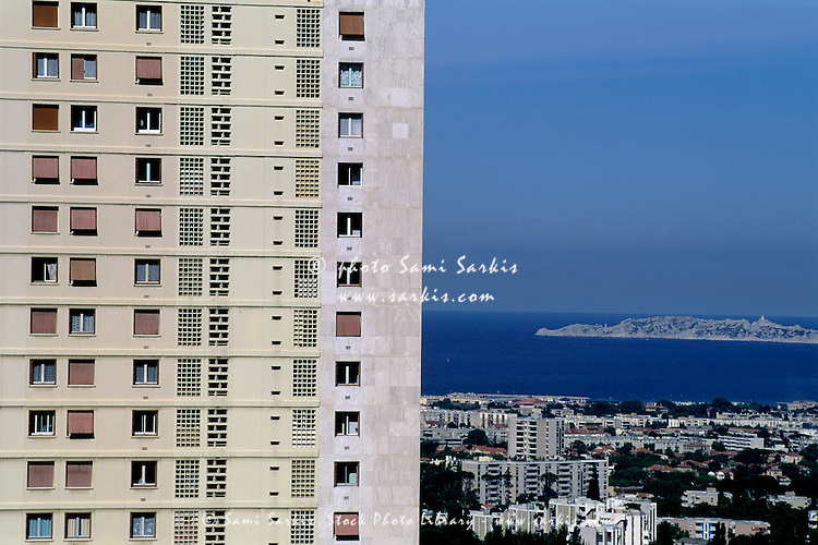 Facade of high-rise with cityscape, Mediterranean Sea and the Frioul Islands in the background, Marseille, France.