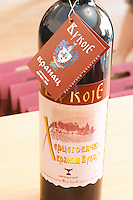 A bottle of Vranac wine., in the winery tasting room. Vukoje winery, Trebinje. Republika Srpska. Bosnia Herzegovina, Europe.
