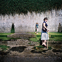 A woman and her child walk near the beach in St Mawes, Cornwall.