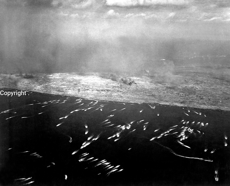 Landing craft brings first wave of invading Yanks to Iwo Jima.  February 1945. (Navy)<br /> Exact Date Shot Unknown<br /> NARA FILE #:  080-G-474953<br /> WAR & CONFLICT BOOK #:  1216