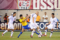 Paulo Henrique Ganso (10) of Brazil battles Michael Bradley (4) of the United States for the ball. The men's national team of Brazil (BRA) defeated the United States (USA) 2-0 during an international friendly at the New Meadowlands Stadium in East Rutherford, NJ, on August 10, 2010.