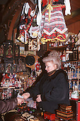Krakow, Poland. Shopper in a souvenir shop.