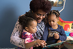 Education Preschool First days of school phase-in toddler -2s program female teacher reading to two girls