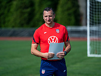 CLEVELAND, OH - SEPTEMBER 14: Vlatko Andonovski of the United States watches his team during a training session at the training fields on September 14, 2021 in Cleveland, Ohio.