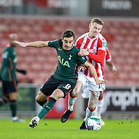 23rd December 2020; Bet365 Stadium, Stoke, Staffordshire, England; English Football League Cup Football, Carabao Cup, Stoke City versus Tottenham Hotspur; Harry Winks of Tottenham Hotspur is tackled by James McClean of Stoke City