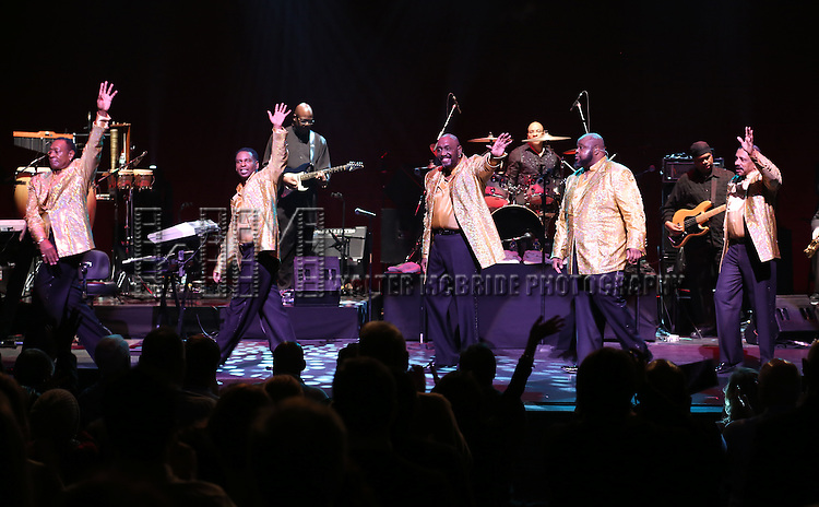Temptations featuring Joe Herndon, Terry Weeks, Otis Williams, Bruce Williamson and Ronald Tyson perform during 'The Temptations And The Four Tops On Broadway' - Curtain Call at Palace Theatre on December 29, 2014 in New York City.