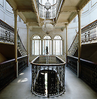 The grand double staircase at Sursock Palace has walls and ceilings clad in marble and banisters made of cast iron
