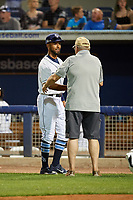 Charlotte Stone Crabs Garrett Whitley (24) shakes hands with a veteran during an on field recognition during a Florida State League game against the Fort Myers Miracle on April 6, 2019 at Charlotte Sports Park in Port Charlotte, Florida.  Fort Myers defeated Charlotte 7-4.  (Mike Janes/Four Seam Images)