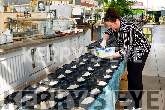 Naomi McDonnell of the Ballyseedy Home and Garden Centre helping putting dinners together for the St Vincent de Paul at the Garden Centre on Saturday.