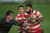 Tavite Gadeisuva tries to evade Courtney Roberts. Counties Manukau Premier Club Rugby game between Karaka and Onewhero, played at Karaka on Saturday June 25th 2016. Karaka won the game 15 - 10 after leading 10 - 3 at halftime.<br />  Photo by Richard Sprnger.