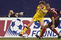 Brian McBride of the Crew works the ball against Steve Jolley of the MetroStars. The Columbus Crew defeated the NY/NJ MetroStars 1-0 on 4/12/03 at Giant's Stadium, NJ.