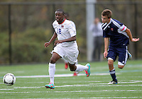 HYATTSVILLE, MD - OCTOBER 26, 2012:  Chris Odoi-Atsem (18) of DeMatha Catholic High School  faces away from Nelson Reed (11) of St. Albans during a match at Heurich Field in Hyattsville, MD. on October 26. DeMatha won 2-0.