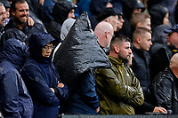 2nd October 2021; Stamford Bridge, Chelsea, London, England; Premier League football Chelsea versus Southampton; Chelsea fan drying to keep dry with a waste bin liner at the Matthew Harding stand