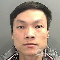 """Pictured: Khuong Van Luong<br /> Re: The ringleaders of a Vietnamese crime gang have been jailed after police seized 2.5 tonnes of cannabis worth about £6m in raids across south Wales.<br /> A total of 21 people have been sentenced in a case going back to 2017 after dozens of cannabis factories were uncovered across the region and beyond.<br /> One of the defendants initially claimed to be 14 years old, but police proved he was actually aged 26.<br /> The gang leaders were sentenced at Merthyr Tydfil Crown Court on Friday.<br /> Bang Xuan Luong, 44, was sentenced to eight years in prison. His partner, 42-year-old Vu Thi Thu Thuy, was jailed for six years and Tuan Anh Pham, 20, who was described in court as the """"IT Man"""", received five years.<br /> An investigation into a cannabis factory in the Cynon Valley led officers from South Wales Police's Force Intelligence and Organised Crime Unit (FIOCU) to a string of others across south Wales, Gwent and Dyfed-Powys force areas."""
