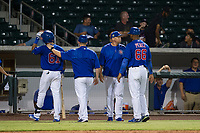 AZL Cubs assistant hitting coach Leonel Perez (66) tries to restrain manager Carmelo Martinez as he argues with home plate umpire Ray Patchen (not pictured) after Yovanny Cuevas (61) was called out for batter interference against the AZL Giants on September 6, 2017 at Sloan Park in Mesa, Arizona. AZL Giants defeated the AZL Cubs 6-5 to even up the Arizona League Championship Series at one game a piece. (Zachary Lucy/Four Seam Images)