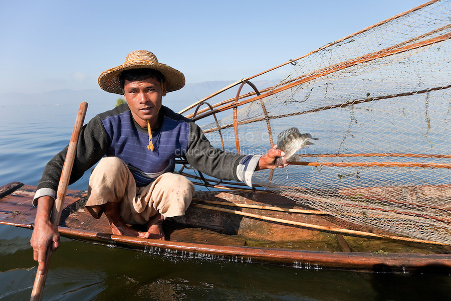 Myanmar, Burma.  Fisherman and Fish, a Meager Catch.  Inle Lake, Shan State.