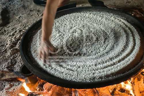 Aldeia Tanguro (Kalapalo), Mato Grosso State, Brazil. Beju cooking on an open fire.
