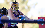 University of Washington's Russell Crandall defeats Air Force's Sam Sheikh in an intercollegiate boxing match at TJ's Corral at Carson Valley Inn, in Minden, Nev., on Saturday, Sept. 13, 2014.<br /> Photo by Cathleen Allison
