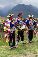 Peru, Moray, Urubamba Valley.  Quechua Musicians Playing to Welcome Guests at Parador de Moray, Andes Mountains in Background.