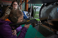 """Switzerland. Canton Ticino. Cureglia is a municipality in the district of Lugano. """"Tiratori del Gaggio"""" society. Shooting range. Young shooters' course. The courses, whose organisation is delegated by the Federal Department of Defence, Civil Protection and Sport to the various local shooting societies, are open to young swiss people, boys and girls, from 15 to 20 years old. Girls and boys learn how to handle and fire with the assault rifle SG 550, also called Fass 90, used by the Swiss Army. Giulia is 15 years old. She shoots her Fass 90 loaded with bullets on targets distant 300 meters under the supervision of her instructor, Sonia Castelli (L). Acoustic foam used inside a pipe in to dampen and absorb the gun shot's sound. The SG 550 is an assault rifle manufactured by Swiss Arms AG (formerly Schweizerische Industrie Gesellschaft) of Neuhausen, Switzerland. """"SG"""" is an abbreviation for Sturmgewehr, or """"assault rifle"""". The rifle is known as the Fass 90 or Stgw 90. An assault rifle is a selective-fire rifle that uses an intermediate cartridge and a detachable magazine. 9.02.2019 © 2019 Didier Ruef"""