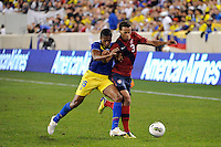 Timmy Chandler (3) of the United States is defended by Antonio Valencia (16) of Ecuador. The men's national team of the United States (USA) was defeated by Ecuador (ECU) 1-0 during an international friendly at Red Bull Arena in Harrison, NJ, on October 11, 2011.