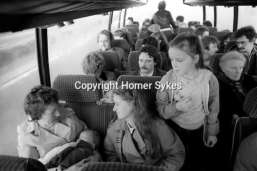 Derry Northern Ireland Londonderry. 1983.  Catholic families on coach to visit relatives on remand and are imprisoned in the Crumlin Road prison jail Belfast