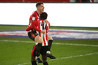Sergi Canos of Brentford leaps into the arms of Josh DaSilva to celebrate after scoring their fifth goal during Brentford vs Wycombe Wanderers, Sky Bet EFL Championship Football at the Brentford Community Stadium on 30th January 2021