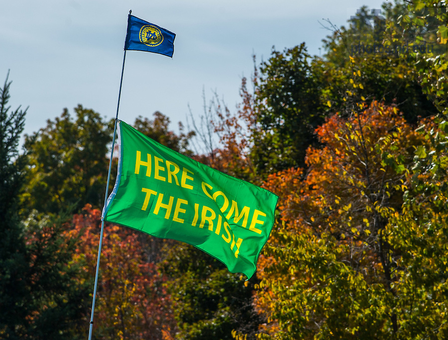 """Oct 11, 2014; A flag with the slogan """"Here Come The Irish"""" flies above a tailgater before the North Carolina game. (Photo by Matt Cashore)"""