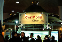 Chinese spectators visits the promotion seat of the ExxonMobil during a curatorial materials exhibition in Xi'an, China..