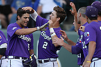 Brance Rivera #5 of the TCU Horned Frogs is greeted by teammate Derek Odell #2 after hitting a home run against the UCLA Bruins at the Los Angeles super regionals at Jackie Robinson Stadium on June 9, 2012 in Los Angeles,California. UCLA defeated TCU 4-1.(Larry Goren/Four Seam Images)
