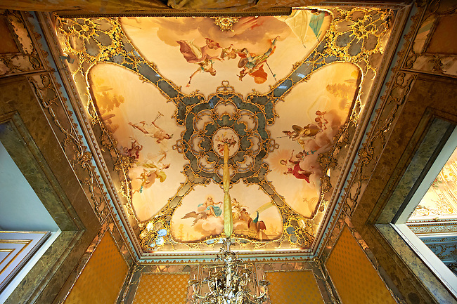 """The workroom of the Queen Mary Caroline. Also called """"the room of Mirrors"""" the frescoed ceiling is by Antonio de Dominici with pairs of mythical figures : Jupiter and Juno, Apollo and Minerva, Mars and the War and Mercury and Prosperpine. The Kings of Naples Royal Palace of Caserta, Italy. A UNESCO World Heritage Site"""