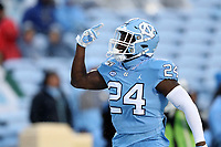 CHAPEL HILL, NC - NOVEMBER 23: Eugene Asante #24 of the University of North Carolina reacts after assisting on a tackle during a game between Mercer University and University of North Carolina at Kenan Memorial Stadium on November 23, 2019 in Chapel Hill, North Carolina.