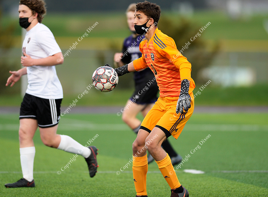 Oregon goaltender, Coltrane LoBreglio, looks to throw the ball back into play, as Oregon takes on Waunakee in Wisconsin WIAA Badger Conference boys high school soccer on Tuesday, Apr. 27, 2021 at Waunakee High School