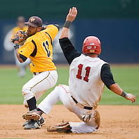 Second baseman Richard Gonzalez #11 of the VCU Rams turns a double play as Greg Hopkins #11 of the St. John's Red Storm tries to break it up at the Charlottesville Regional of the 2010 College World Series at Davenport Field on June 5, 2010, in Charlottesville, Virginia.  The Red Storm defeated the Rams 8-6.  Photo by Brian Westerholt / Four Seam Images