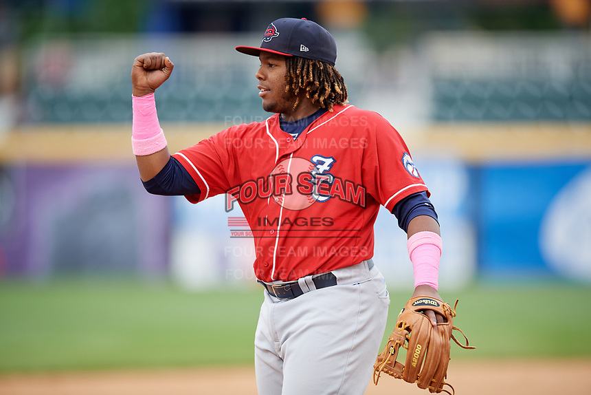 New Hampshire Fisher Cats third baseman Vladimir Guerrero Jr. (27) pumps his first during the first game of a doubleheader against the Harrisburg Senators on May 13, 2018 at FNB Field in Harrisburg, Pennsylvania.  New Hampshire defeated Harrisburg 6-1.  (Mike Janes/Four Seam Images)