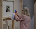 """Barbican Art Gallery stages the first UK survey of American documentary photographer, Dorothea Lange (1895 - 1965). The exhibition opens to the public on June 22nd, (lower gallery) in parallel with the exhibition Vanessa Winship: And Time Folds (upper gallery). Both exhibitions run until 2nd September 2018. Picture shows: a visitor records the iconic """"Migrant Mother""""."""