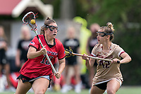 NEWTON, MA - MAY 14: Cameryn Dera #10 of Fairfield University on the attack as Hunter Roman #42 of Boston College defends during NCAA Division I Women's Lacrosse Tournament first round game between Fairfield University and Boston College at Newton Campus Lacrosse Field on May 14, 2021 in Newton, Massachusetts.