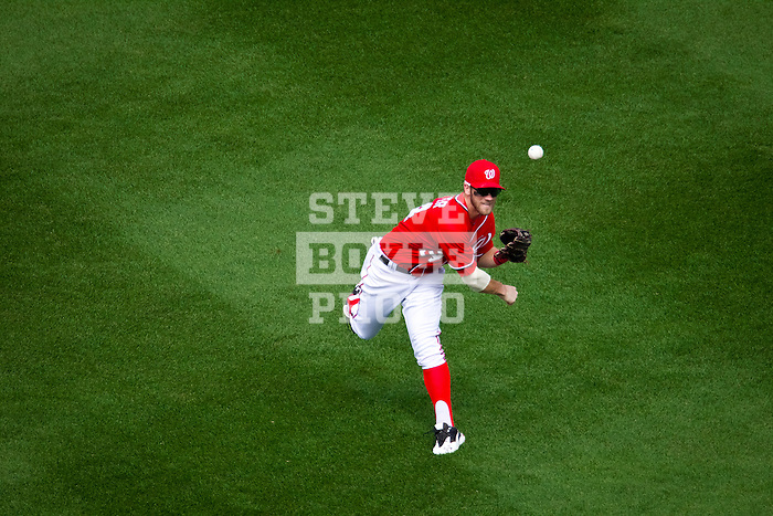 Washington Nationals outfielder Bryce Harper (34) plays a fly ball during a game against the Miami Marlins at Nationals Park in Washington, DC on September 8, 2012.