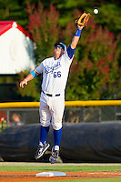 First baseman Murray Watts #66 of the Burlington Royals can't handle a high throw during the game against the Bristol White Sox at Burlington Athletic Park on July 9, 2011 in Burlington, North Carolina.  The Royals defeated the White Sox 3-2.   (Brian Westerholt / Four Seam Images)