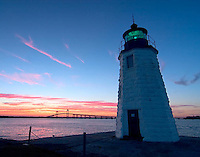 Goat Island Light glows green as another days comes to a close